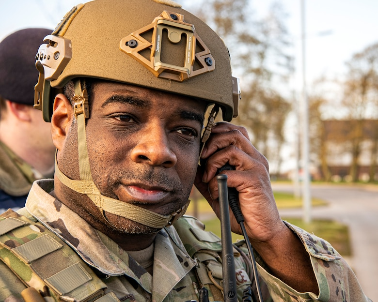 Tech Sgt. Lamont Hudson, 423d Security Forces Squadron NCO in charge of operations support, listens to a radio during a readiness exercise, at RAF Molesworth, England, Feb. 11, 2020. The exercise tested the wing's preparedness and response capabilities to an emergency situation. (U.S. Air Force photo by Senior Airman Eugene Oliver)
