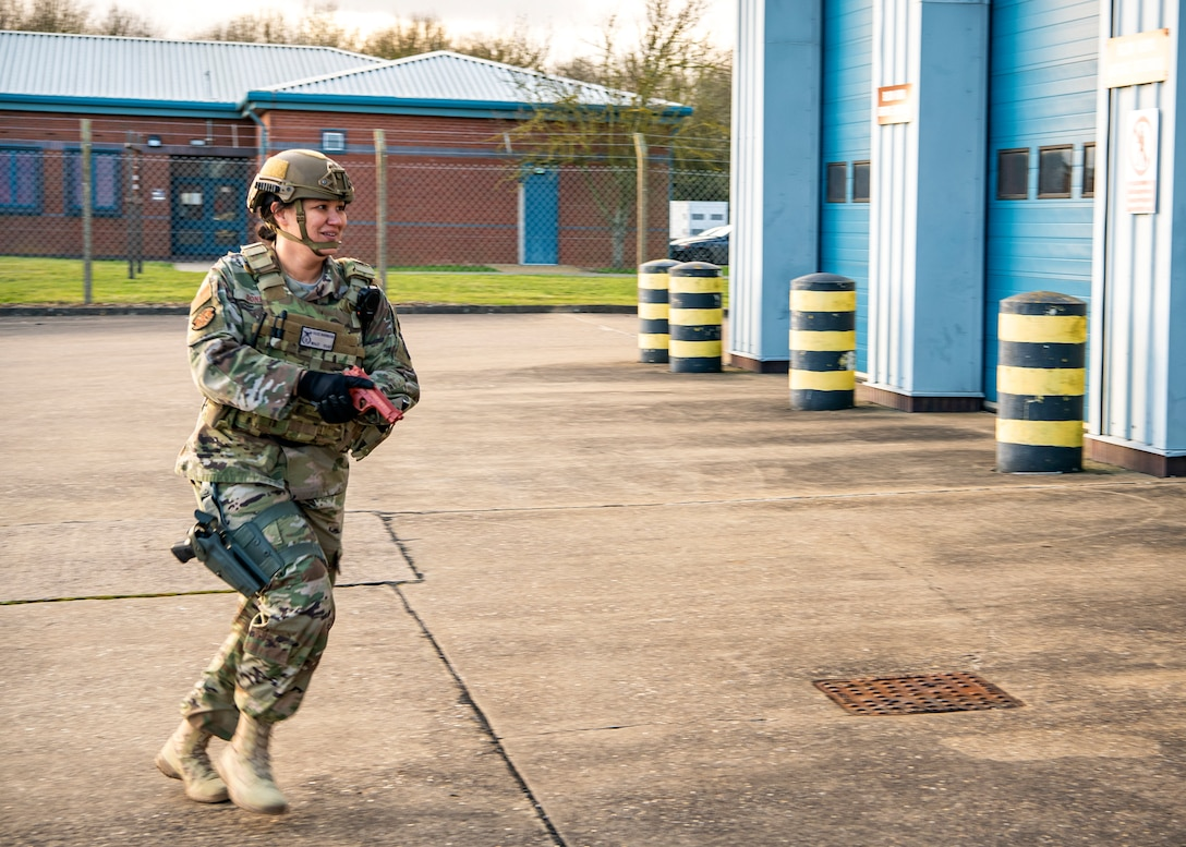 Master Sgt. Suzanna Donkor, 423d Security Forces Squadron flight chief, prepares to enter a building as a first responder during a readiness exercise, at RAF Molesworth, England, Feb. 11, 2020. The exercise tested the wing's preparedness and response capabilities to an emergency situation. (U.S. Air Force photo by Senior Airman Eugene Oliver)