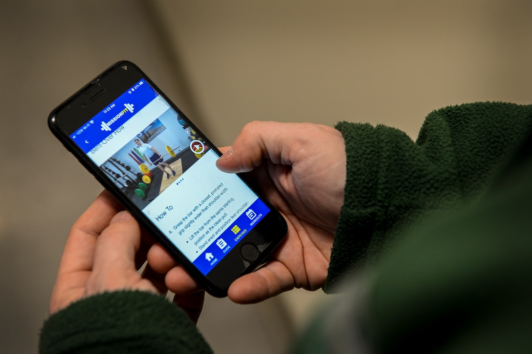 A smartphone user navigates the Defense Health Agency's newest health and wellness app, Air Force MissionFit, at Hanscom Air Force Base, Mass., Feb. 13. The app offers a 12-week program of exercise routines along with a library of more than 90 exercises and detailed instructions with video, images and text. (U.S. Air Force photo by Lauren Russell)