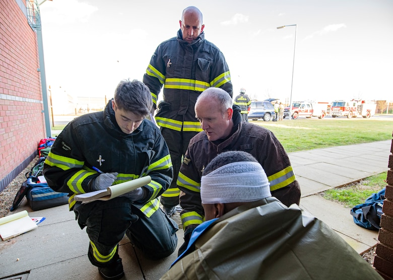 Firefighters from the 422d Civil Engineer Squadron, take vitals from a simulated victim during a readiness exercise, at RAF Molesworth, England, Feb. 11, 2020.  The exercise tested the wing's preparedness and response capabilities to an emergency situation. (U.S. Air Force photo by Senior Airman Eugene Oliver)