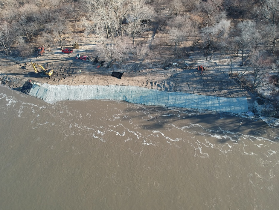 Aerial view shows contractors installing fleximat on the Western Sarpy levee repair project.