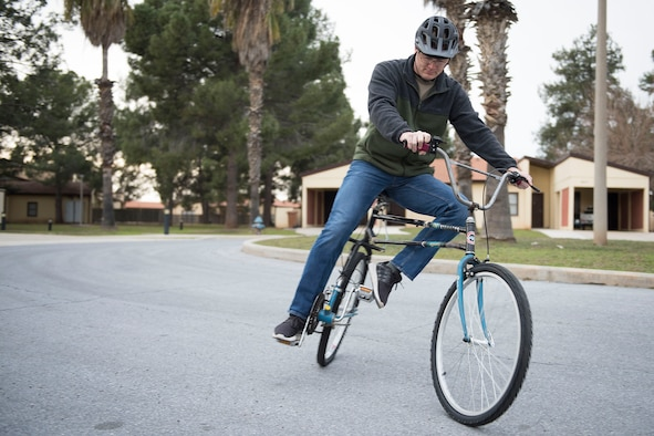 U.S. Air Force Staff Sgt. Mann, 39th Air Base Wing Public Affairs broadcast journalist, displays the range of motion a swing bike is capable of Feb. 12, 2020, at Incirlik Air Base, Turkey.