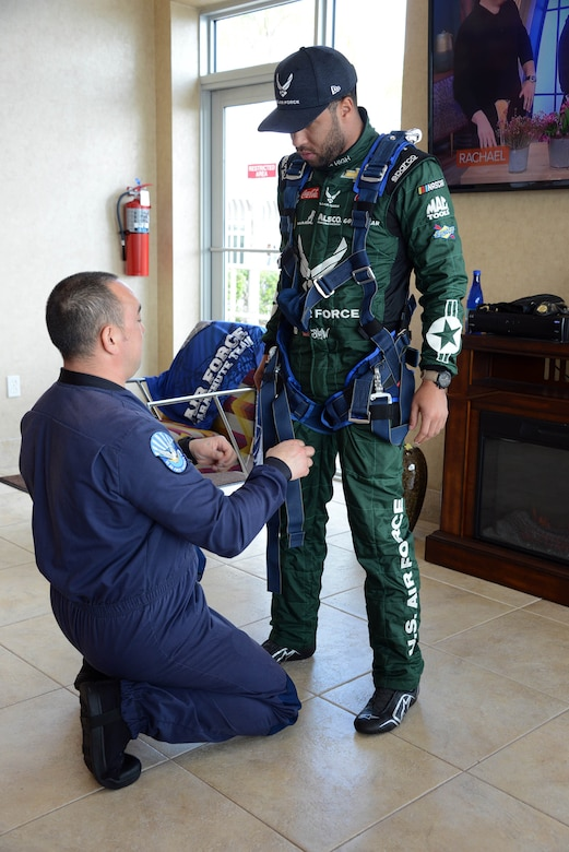 Bubba Wallace, driver of Richard Petty Motorsport's No. 43 car, gets suited up by a member of the U.S. Wings of Blue prior to making a grand entrance to this year's Daytona 500 race.