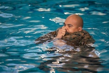 A U.S. Marine  with H&S Battalion, Marine Corps Installations East-Marine Corps Base Camp Lejeune, conducts a 4-minute water tread during the basic qualification segment of the Marine Corps Water Survival Training Program at on MCB Camp Lejeune, Feb. 7, 2020.
