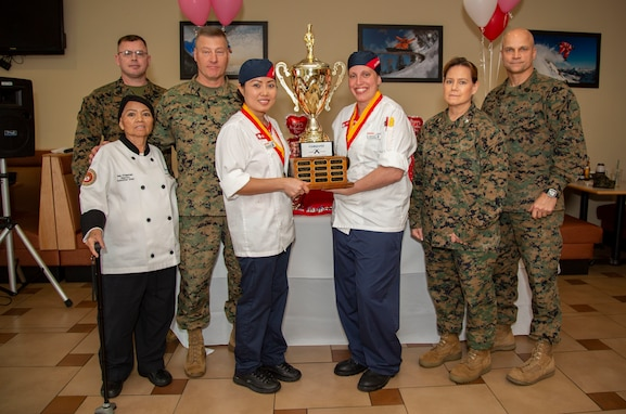 Courtney Naro and Sompone Douangdara, both Sodexo food service specialists with the French Creek dining facility on MCB Camp Lejeune were awarded 1st place during a culinary competition at the Wallace Creek dining facility on MCB Camp Lejeune, North Carolina, Feb. 11, 2020.
