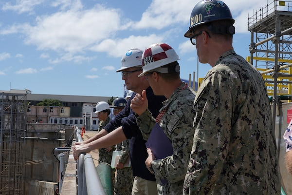 James F. Geurts, assistant secretary of the Navy for research, development and acquisition, looks into Pearl Harbor Naval Shipyard & Intermediate Maintenance Facility's Dry Dock #3. In Fiscal Year 2023 once the last Los Angeles-class submarine availability is complete, the shipyard's Dry Dock #3 will become obsolete due to its size. To maintain and grow PHNSY & IMF's nuclear maintenance capacity and provide best value to taxpayers, the Shipyard Infrastructure Optimization Program will optimize this critical shipyard location.