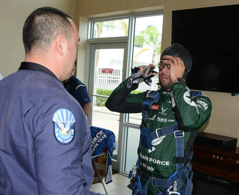 Bubba Wallace, driver of Richard Petty Motorsport's No. 43 car, gets suited up by a member of the U.S. Wings of Blue prior to making a grand entrance to this year's Daytona 500 race