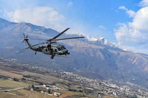 An HH-60G Pave Hawk helicopter flies over Aviano Air Base