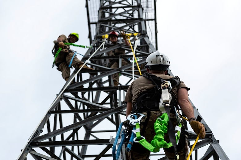 Airfield and weather systems journeyman, and apprentice rappel down a radio antenna tower