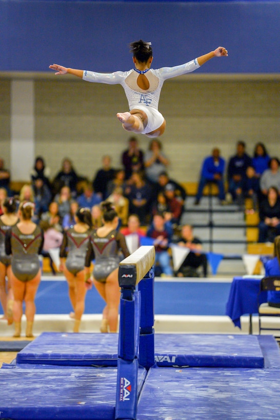 Air Force Academy cadet performs on a balance beam during a gymnastics meet