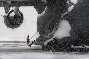 Airman 1st Class enters a C-17 Globemaster III