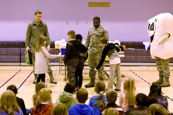 U.S. Air Force Capt. Anthony Ewell-Kollmann, a 354th Medical Group Dental Flight general dentist, and Staff Sgt. Kaleb Hatfield, a 354th MDG Dental Flight dental assistant, lead a dental flossing activity with a jump rope at Crawford Elementary School at Eielson Air Force Base, Alaska, Feb. 13, 2020.
