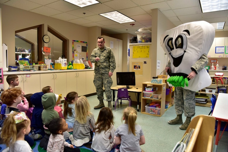 U.S. Air Force Capt. Glen Myers, a 354th Medical Group Dental Flight general dentist, talks to children at the child development center on Eielson Air Force Base, Alaska, Feb. 11, 2020.