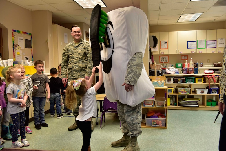 A child practices her tooth brushing technique on a tooth mascot at the child development center on Eielson Air Force Base, Alaska, Feb. 11, 2020.