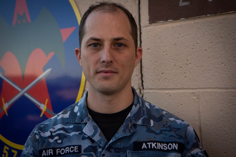 Royal Australian Air Force member,  poses for a photo.