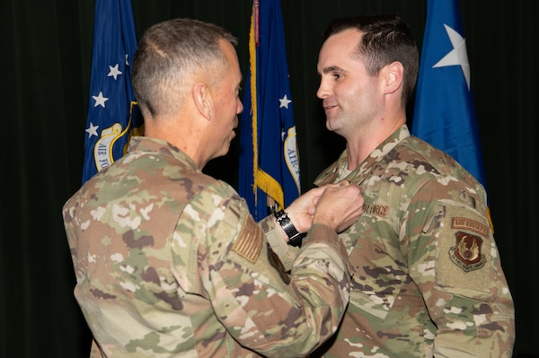 Maj. Gen. Tom Wilcox, Air Force Installation and Mission Support Center commander, awards the Bronze Star to Capt. Shane Lockridge at a commander's call Feb. 13.