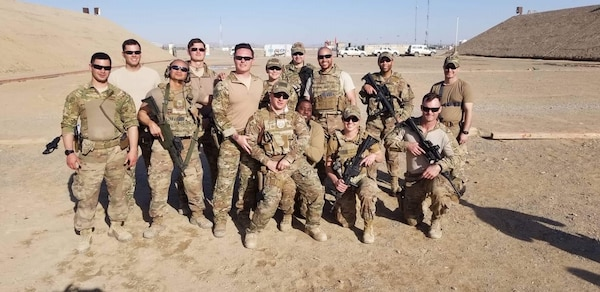 Capt. Shane Lockridge (front row kneeling first from the left) poses with his members of his team assigned to the 738th Air Expeditionary Advisory Group in Kandahar, Afghanistan.
