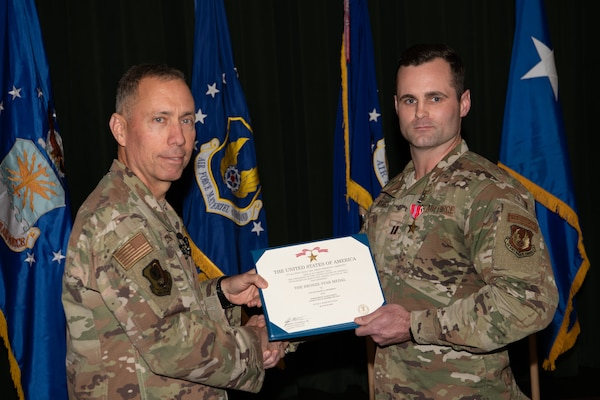 Maj. Gen. Tom Wilcox, Air Force Installation and Mission Support Center commander, stand with Capt. Shane Lockridge after awarding the Bronze Star to him at a commander's call Feb. 13.