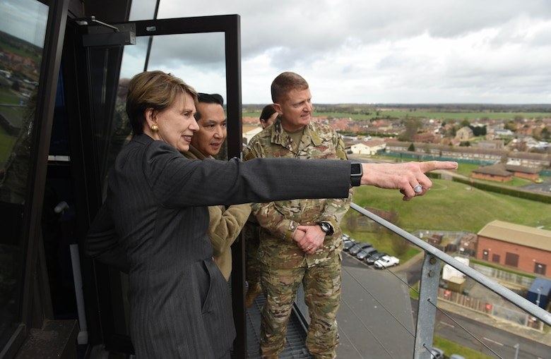 Secretary of the Air Force Barbara Barrett looks out over the base and surrounding community with Col. Troy Pananon, 100th Air Refueling Wing commander, and Col. Clay Freeman, 352 Special Operations Wing commander, atop the air traffic control tower during her visit to RAF Mildenhall, England, Feb. 13, 2020. During Barrett's visit she spoke to members of RAF Mildenhall about Team Mildenhall's mission, Air Force modernization and listen to their innovative ideas on how to improve the base. (U.S. Air Force photo by Staff Sgt. Luke Milano)