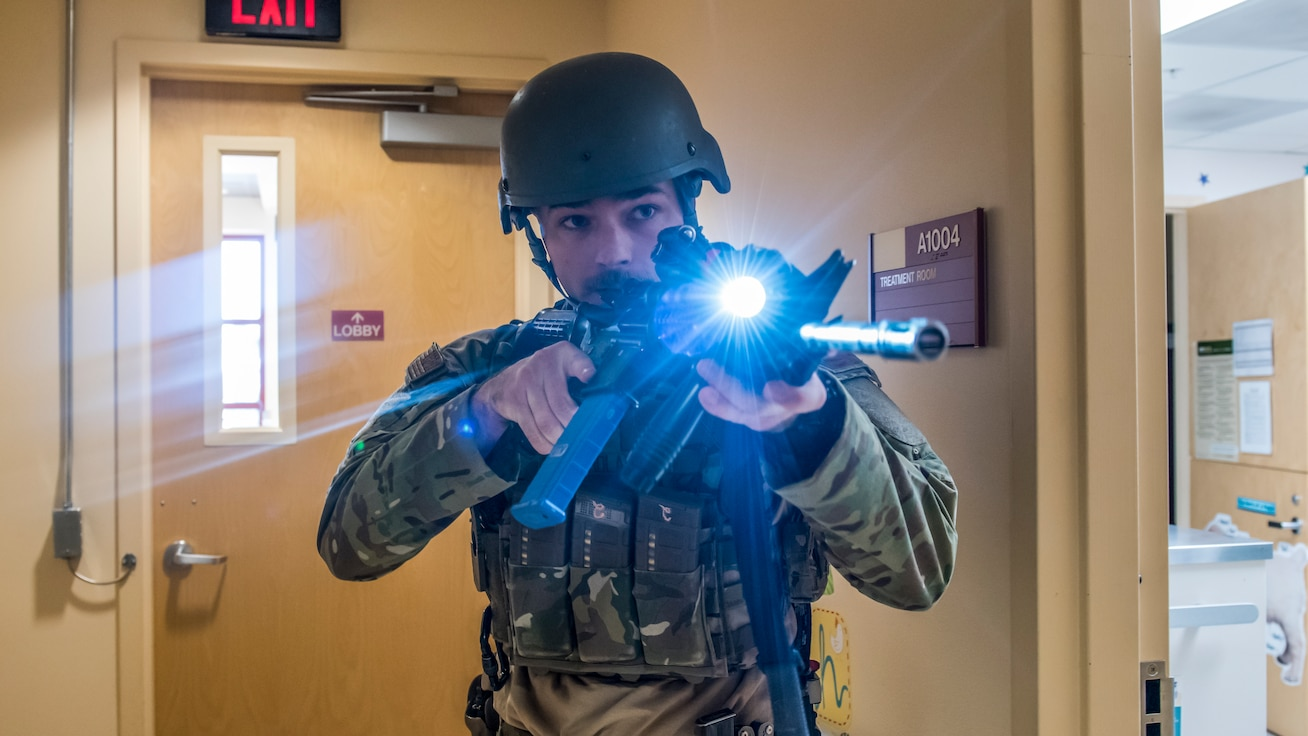 Senior Airman Richard Nicholas, 412th Security Forces Squadron, moves down a hallway to secure it during an active shooter exercise at Edwards Air Force Base, California, Feb. 11. (Air Force photo by Richard Gonzales)