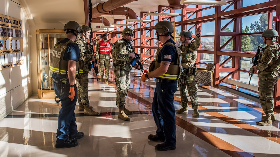 Airmen with the 412th Security Forces confer with members of the Edwards AFB Fire Department during an active shooter exercise at Edwards Air Force Base, California, Feb. 11. (Air Force photo by Richard Gonzales)