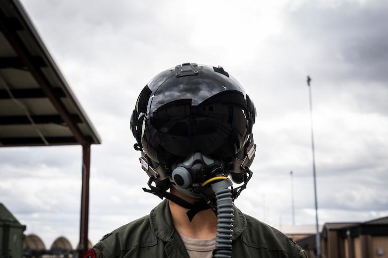 A photo of a pilot wearing a helmet