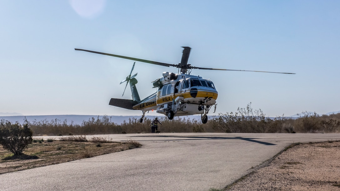 A helicopter from the Los Angeles County Fire Department lands near the base clinic during an active shooter exercise at Edwards Air Force Base, California, Feb. 11. The victims were transported to the Antelope Valley Hospital in nearby Lancaster, California. (Air Force photo by Richard Gonzales)