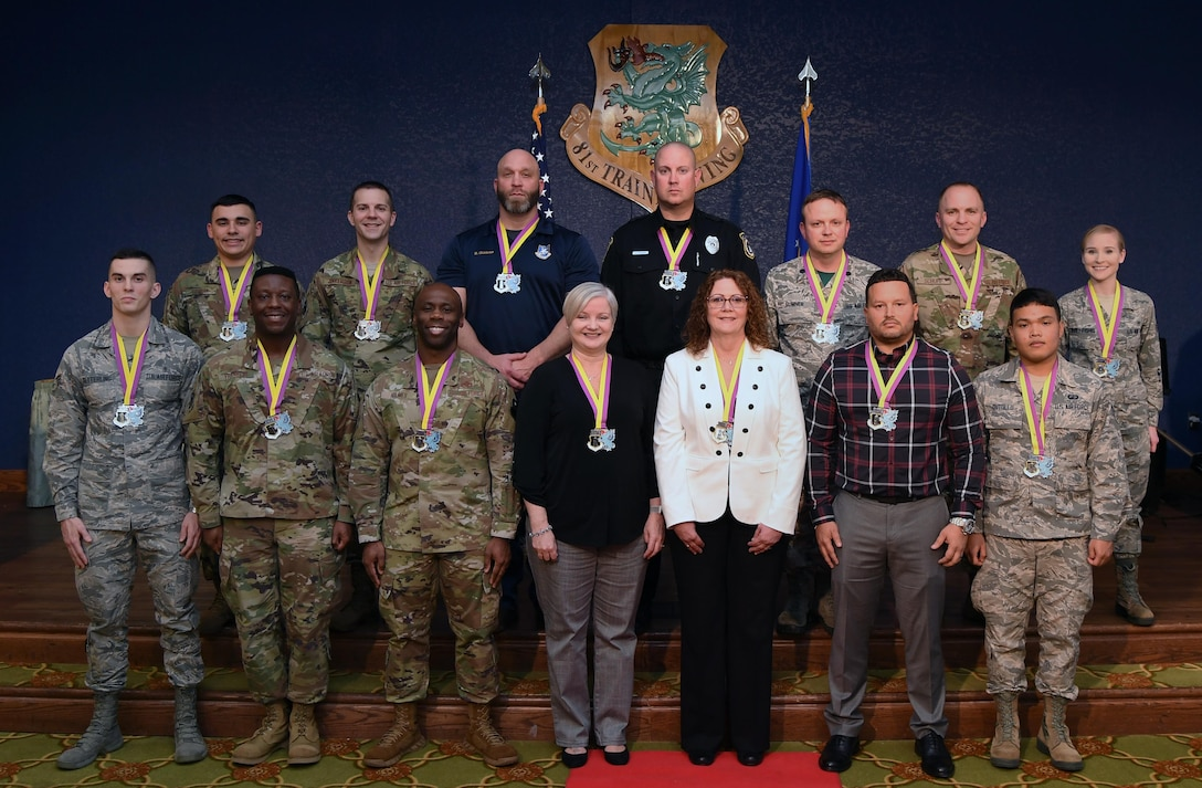 Winners of the 81st Training Wing's 2019 Annual Awards Ceremony pose for a photo inside the Bay Breeze Event Center at Keesler Air Force Base, Mississippi, Feb. 14, 2020. During the ceremony, base leadership recognized outstanding Airmen and civilians from across the installation for their accomplishments throughout 2019. (U.S. Air Force photo by Kemberly Groue)
