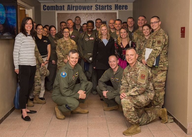 Airmen and spouses involved in the 19th Air Force command team tour, pose for a picture, Feb. 13, 2020, on Holloman Air Force Base, N.M. The 19th AF command team toured 49th Wing facilities, focusing on recognizing Airmen making an impact on the mission. (U.S. Air Force photo by Airman 1st Class Autumn Vogt)