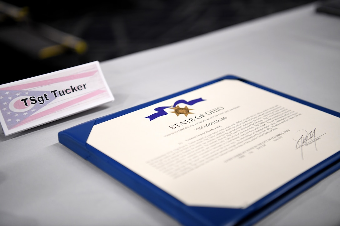 The citation for the Ohio Cross sits on a table after Ohio's Lt. Governor Jon Husted awarded the Ohio Cross to U.S. Air Force Master Sgt. Ryan Tucker during the Ohio National Guard's Joint Senior Leaders Conference Feb. 14, 2020 in Columbus, Ohio. The Ohio Cross is awarded to any member of the state military forces who distinguishes themselves by gallantry and intrepidity at the risk of his/her life. (U.S. Air Force photo by Tech. Sgt. Shane Hughes)