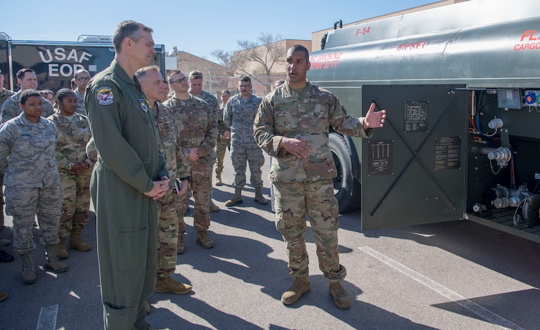 Maj. Gen. Craig Wills, 19th Air Force commander, is briefed on an R-13 Mobile Refueling Unit by Senior Airman Michael Ricci, 49th Logistics Readiness Squadron preventive maintenance technician, Feb. 14, 2020, on Holloman Air Force Base, N.M. Ricci fitted an adapter and nozzle on the R-13 to prevent fuel commingling, which is the mixing of two separate products, such as gasoline in an aircraft or jet fuel into diesel vehicle. (U.S. Air Force photo by Airman 1st Class Quion Lowe)
