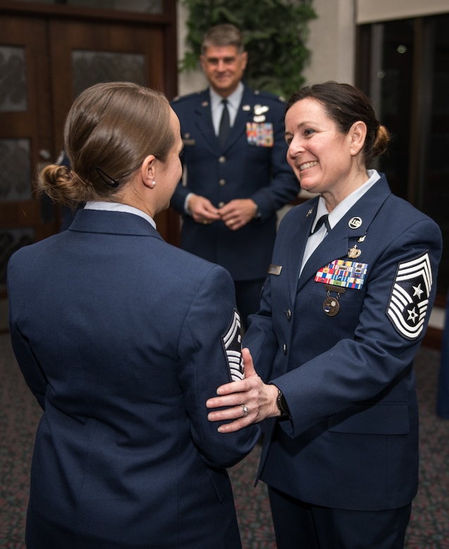Chief Master Sgt. Barbara Gilmore, 932nd Airlift Wing Command, congratulates Senior Master Sgt. Tabitha Knupp on her selection as an Annual Award nominee in the First Sergeant category during the pre Awards Banquet ceremony, Feb. 8, 2020, Scott Air Force Base, Illinois.  Col. Glenn Collins, commander, 932nd AW, joined Gilmore during the ceremony and presented each nominee with a Wing coin. (U.S. Air Force photo by Christopher Parr)