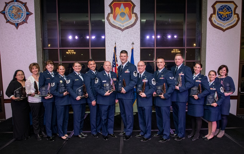 Annual Awards winners  from the 932nd Airlift Wing and 954th Reserve Support Squadron here at Scott Air Force Base, Illinois, pose for a photo following the 3rd Annual Awards Banquet, Feb. 8, 2020. (U.S. Air Force photo by Christopher Parr)