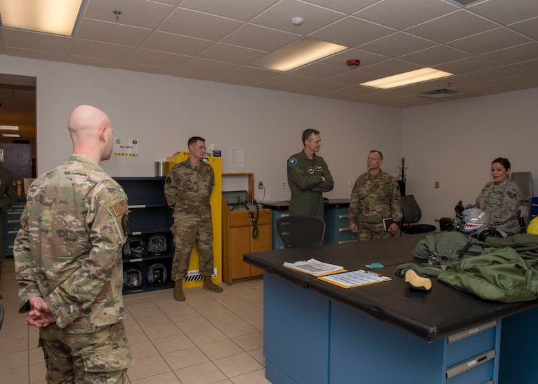 Airmen with the 314th Attack Squadron aircrew flight equipment shop speak with the 19th Air Force command team, Feb. 13, 2020, on Holloman Air Force Base, N.M. The 19th AF command team toured 49th Wing facilities, focusing on recognizing Airmen making a positive impact on the mission. (U.S. Air Force photo by Airman 1st Class Autumn Vogt)
