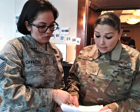 Master Sgt. Mariya Cavazos, Financial Services office flight chief at Ellsworth Air Force Base, South Dakota, shares information about a travel pay process with Master Sgt. Sedelia Cordero, financial operations flight chief at Dover Air Force Base, Delaware, during the 2020 Air Force Financial Operations Conference in San Antonio. (Air Force photo by Ed Shannon)