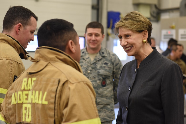 Secretary of the Air Force Barbara Barrett meets with Airmen from the 100th Civil Engineer Squadron fire department during her visit to RAF Mildenhall, England, Feb. 13, 2020.  Barrett stopped at the air traffic control tower, fire station and various units within the 352 Special Operations Wing during her visit. (U.S. Air Force photo by Staff Sgt. Luke Milano)