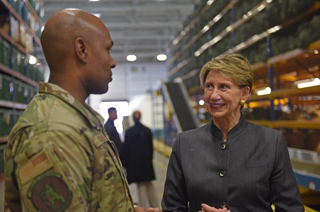 Tech. Sgt. Ralph Steele, 100th Logistics Readiness Squadron section chief of plans and integration, speaks to Secretary of the Air Force Barbara Barrett during her visit to RAF Mildenhall, England, Feb. 13, 2020. Barrett's visit to RAF Mildenhall was her first as the 25th Secretary of the Air Force. (U.S. Air Force photo by Staff Sgt. Luke Milano)