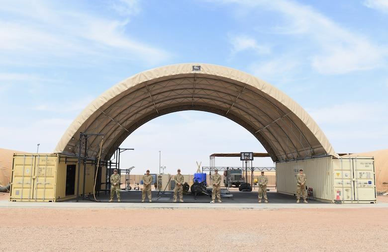 Photo of Airmen constructing an outdoor gym.