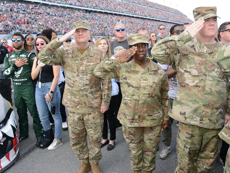 Bubba Wallace, driver of Richard Petty Motersports No. 43 car, Lt. Gen. Brad Webb, Air Education and Training commander and members of Air Force Recruiting Service salute the flag during the National Anthem at the 2020 Daytona 500.