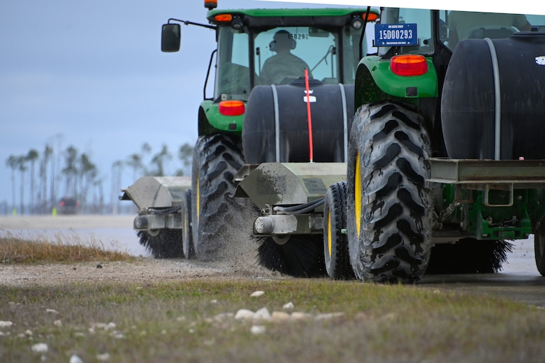 Photo of tractors cleaning runway