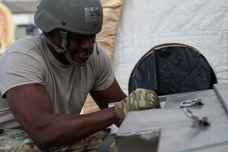 Photo of Airman working on equipment.