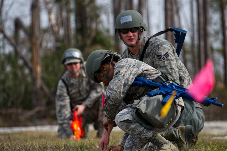 Photo of Airmen working in field.
