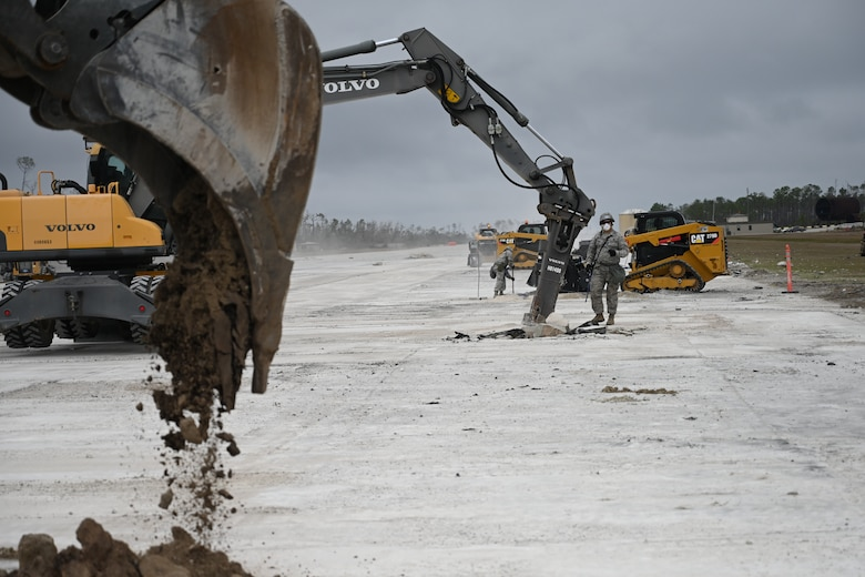 Photo of heavy equipment working on runway.