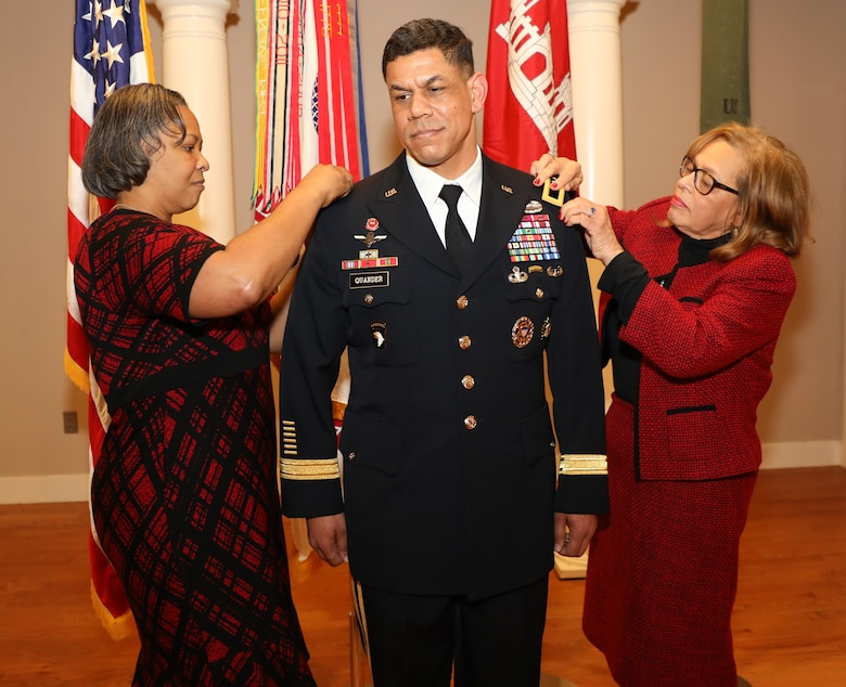 Brig. Gen. Mark Quander's new rank is pinned to his uniform by his wife, Lt. Col. (ret.) Melonie Quander (left) and his mother Gail. Brig. Gen. Quander is the Commandant of the U.S. Army Engineer School at Fort Leonard Wood, Missouri, but was promoted during a ceremony at Joint Base Myer-Henderson Hall in Arlington, Virginia, on Feb. 14, 2020.