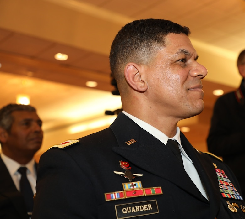 Col. Mark Quander listens to a speaker during his promotion ceremony to brigadier general. Quander is the commandant of the U.S. Army Engineer School at Fort Leonard Wood, Missouri, but was promoted during a ceremony at Joint Base Myer-Henderson Hall in Arlington, Virginia, on Feb. 14, 2020.