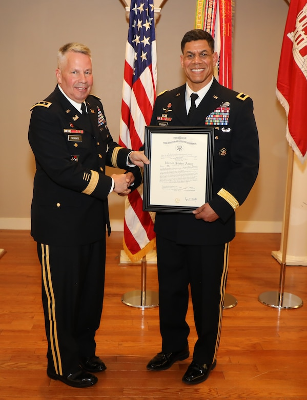 Lt. Gen. Todd T. Semonite, USACE Commanding General and 54th U.S. Army Chief of Engineers presents Brig. Gen. Mark Quander with a certificate of promotion. Quander, the commandant of the U.S. Army Engineer School, was promoted to the rank of Brigadier General at Fort Myer, Virginia on Feb. 14, 2020.