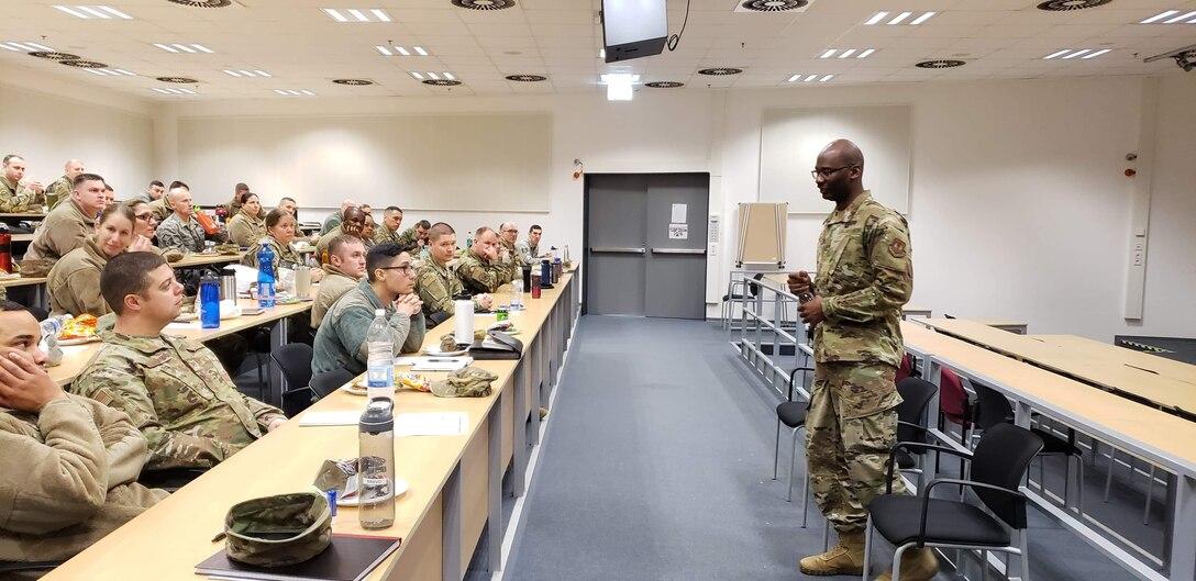 Photo of first sergeant speaking to Airmen