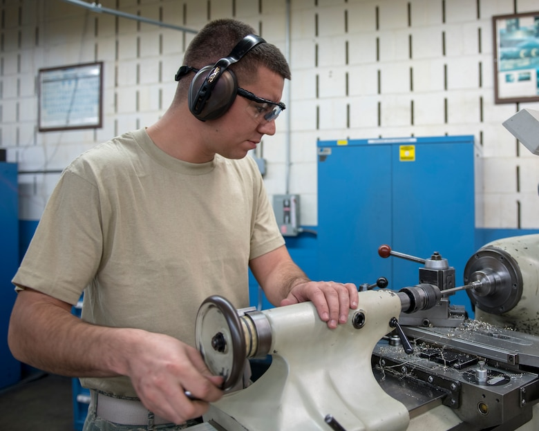 Airman 1st Class Arnoldo Madrigal, 4th Equipment Maintenance Squadron metals technology fabrication flight apprentice, uses a lathe to fabricate a bushing, Feb. 4, 2020, at Seymour Johnson Air Force Base, N.C.