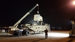 Soldiers of the 1107th Theater Aviation Sustainment Maintenance Group work to reassemble a CH-47 (Chinook) helicopter at Camp Buehring, Kuwait, Jan. 26, 2020. (Courtesy photo)