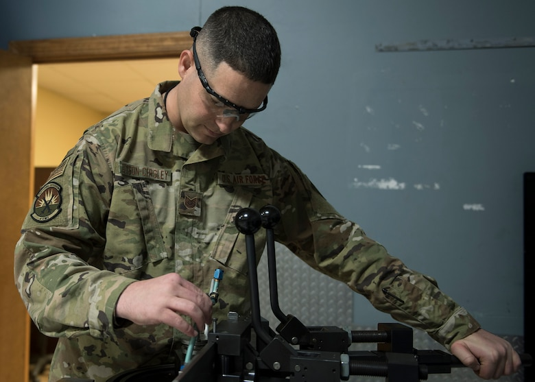 Tech. Sgt. Robert Dyson-Cersley, 4th Equipment Maintenance Squadron aircraft structural maintenance production supervisor, bends a fuel sense line tubing assembly using a production tube bender, Feb. 4, 2020, at Seymour Johnson Air Force Base, N.C.